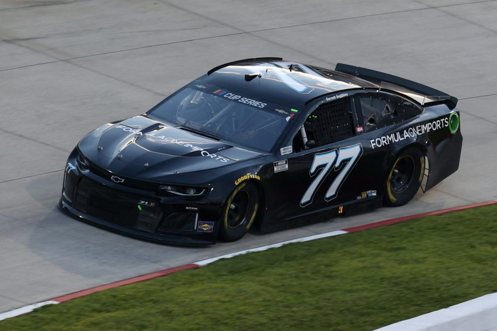 MARTINSVILLE, VIRGINIA - JUNE 10: Garrett Smithley, driver of the #77 Formula One Imports Chevrolet, drives during the NASCAR Cup Series Blue-Emu Maximum Pain Relief 500 at Martinsville Speedway on June 10, 2020 in Martinsville, Virginia. (Photo by Rob Carr/Getty Images) | Getty Images
