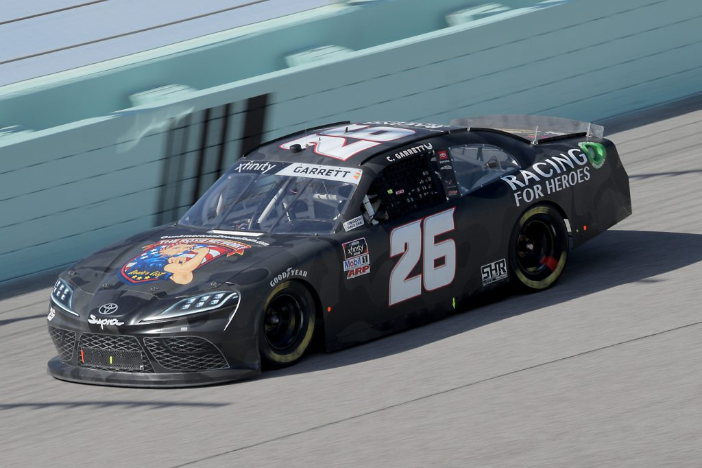 HOMESTEAD, FLORIDA - JUNE 13: Colin Garrett, driver of the #26 Rosie Network/R4H Toyota, races during the NASCAR Xfinity Series Hooters 250 at Homestead-Miami Speedway on June 13, 2020 in Homestead, Florida. (Photo by Chris Graythen/Getty Images) | Getty Images