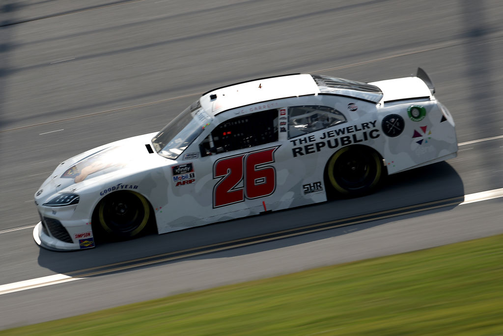 TALLADEGA, ALABAMA - JUNE 20: Colin Garrett, driver of the #26 Rosie Network Toyota, drives during the NASCAR Xfinity Series Unhinged 300 at Talladega Superspeedway on June 20, 2020 in Talladega, Alabama. (Photo by Chris Graythen/Getty Images) | Getty Images