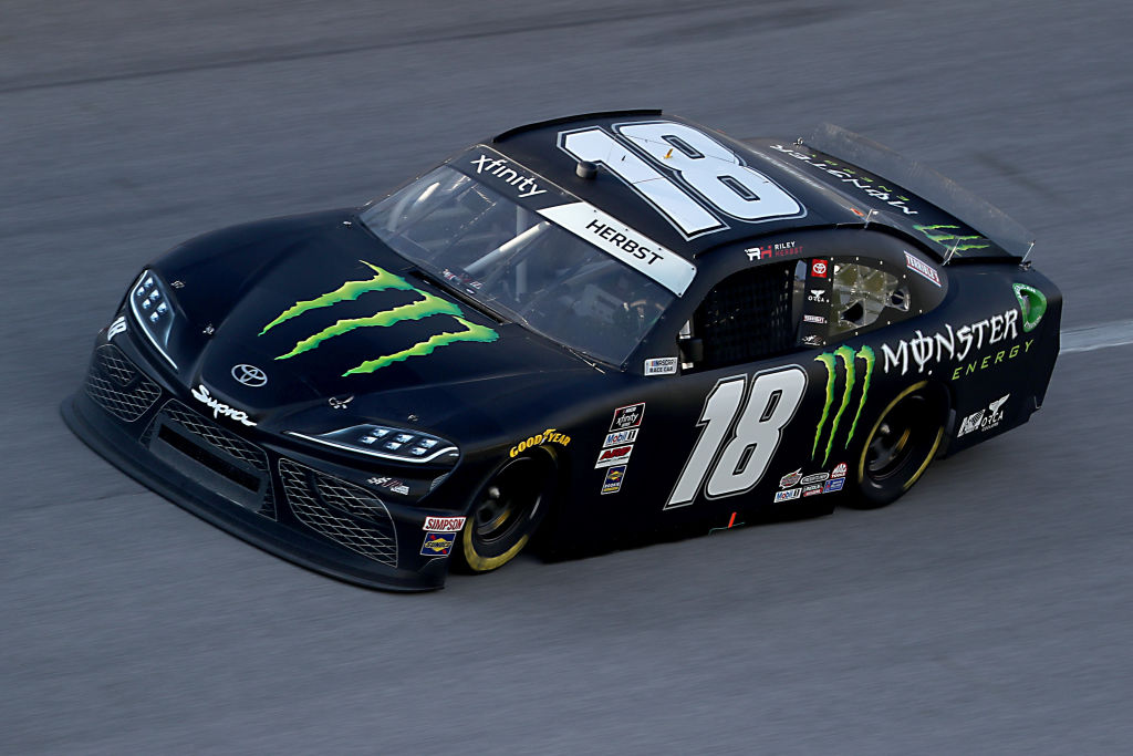 TALLADEGA, ALABAMA - JUNE 20: Riley Herbst, driver of the #18 Monster Energy Toyota, races during the NASCAR Xfinity Series Unhinged 300 at Talladega Superspeedway on June 20, 2020 in Talladega, Alabama. (Photo by Chris Graythen/Getty Images) | Getty Images