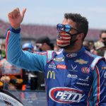 TALLADEGA, ALABAMA - JUNE 22:  Bubba Wallace, driver of the #43 Victory Junction Chevrolet, gives a thumbs up prior to the NASCAR Cup Series GEICO 500 at Talladega Superspeedway on June 22, 2020 in Talladega, Alabama. A noose was found in the garage stall of NASCAR driver Bubba Wallace at Talladega Superspeedway a week after the organization banned the Confederate flag at its facilities. (Photo by Chris Graythen/Getty Images) | Getty Images