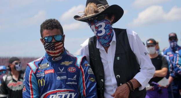 TALLADEGA, ALABAMA - JUNE 22:  Team owner and NASCAR Hall of Famer Richard Petty stands with Bubba Wallace, driver of the #43 Victory Junction Chevrolet, during pre-race ceremonies prior to the NASCAR Cup Series GEICO 500 at Talladega Superspeedway on June 22, 2020 in Talladega, Alabama. A noose was found in the garage stall of NASCAR driver Bubba Wallace at Talladega Superspeedway a week after the organization banned the Confederate flag at its facilities. (Photo by Chris Graythen/Getty Images) | Getty Images