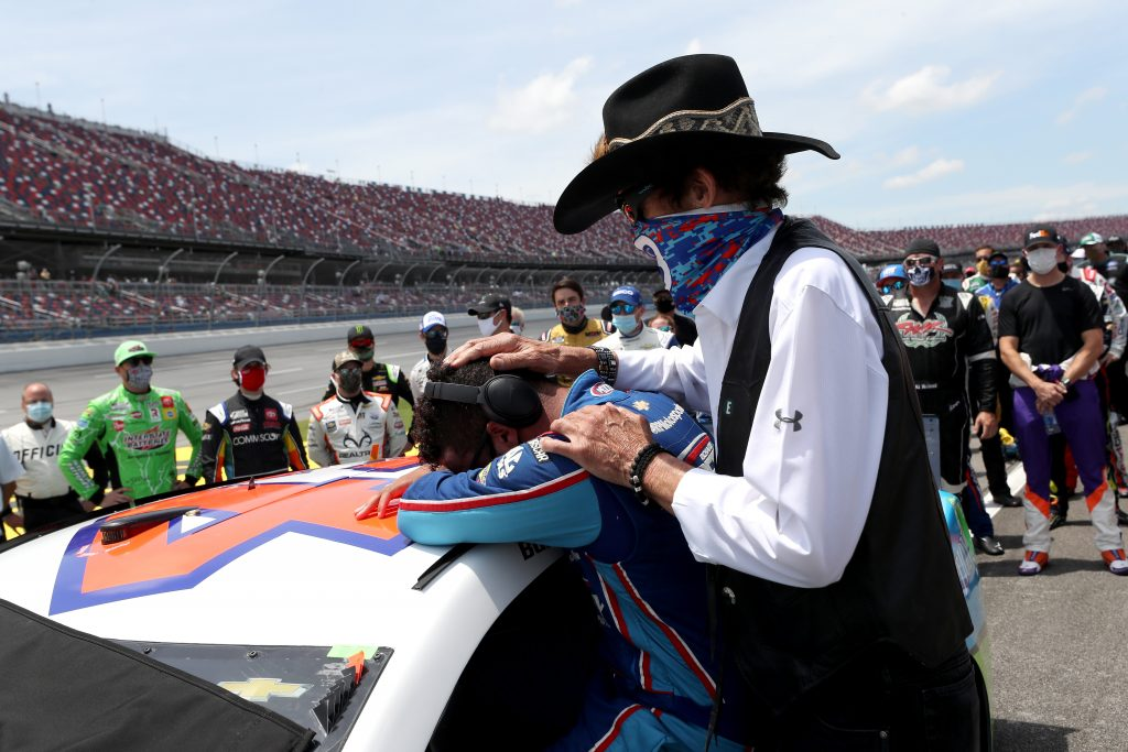 TALLADEGA, ALABAMA - JUNE 22: Bubba Wallace, driver of the #43 Victory Junction Chevrolet, is embraced by team owner, and NASCAR Hall of Famer Richard Petty prior to the NASCAR Cup Series GEICO 500 at Talladega Superspeedway on June 22, 2020 in Talladega, Alabama. A noose was found in the garage stall of NASCAR driver Bubba Wallace at Talladega Superspeedway a week after the organization banned the Confederate flag at its facilities. (Photo by Chris Graythen/Getty Images) | Getty Images