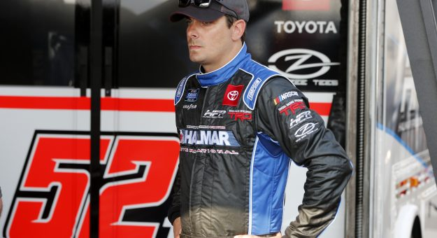 DAYTONA BEACH, FLORIDA - FEBRUARY 13: Stewart Friesen, driver of the #52 Halmar International Toyota, stands in the garage area during practice for the NASCAR Gander RV and Outdoors Truck Series NextEra Energy 250 at Daytona International Speedway on February 13, 2020 in Daytona Beach, Florida. (Photo by Brian Lawdermilk/Getty Images)   Getty Images