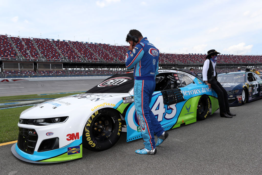 TALLADEGA, ALABAMA - JUNE 22:  Bubba Wallace, driver of the #43 Victory Junction Chevrolet, and team owner, and NASCAR Hall of Famer Richard Petty wait on the grid prior to the NASCAR Cup Series GEICO 500 at Talladega Superspeedway on June 22, 2020 in Talladega, Alabama. A noose was found in the garage stall of NASCAR driver Bubba Wallace at Talladega Superspeedway a week after the organization banned the Confederate flag at its facilities. (Photo by Chris Graythen/Getty Images) | Getty Images