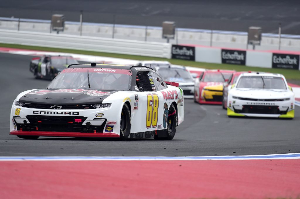 CONCORD, NORTH CAROLINA - OCTOBER 10: Brandon Brown, driver of the #68 Ray's Siding Co. Chevrolet, leads the field during the NASCAR Xfinity Series Drive for the Cure 250 presented by Blue Cross Blue Shield of North Carolina at Charlotte Motor Speedway on October 10, 2020 in Concord, North Carolina. (Photo by Jared C. Tilton/Getty Images) | Getty Images