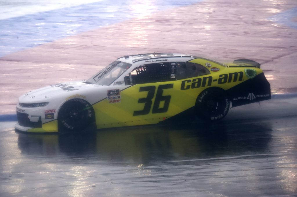 CONCORD, NORTH CAROLINA - OCTOBER 10: Alex Labbe, driver of the #36 Can-Am Chevrolet, drives in the rain during the NASCAR Xfinity Series Drive for the Cure 250 presented by Blue Cross Blue Shield of North Carolina at Charlotte Motor Speedway on October 10, 2020 in Concord, North Carolina. (Photo by Jared C. Tilton/Getty Images) | Getty Images