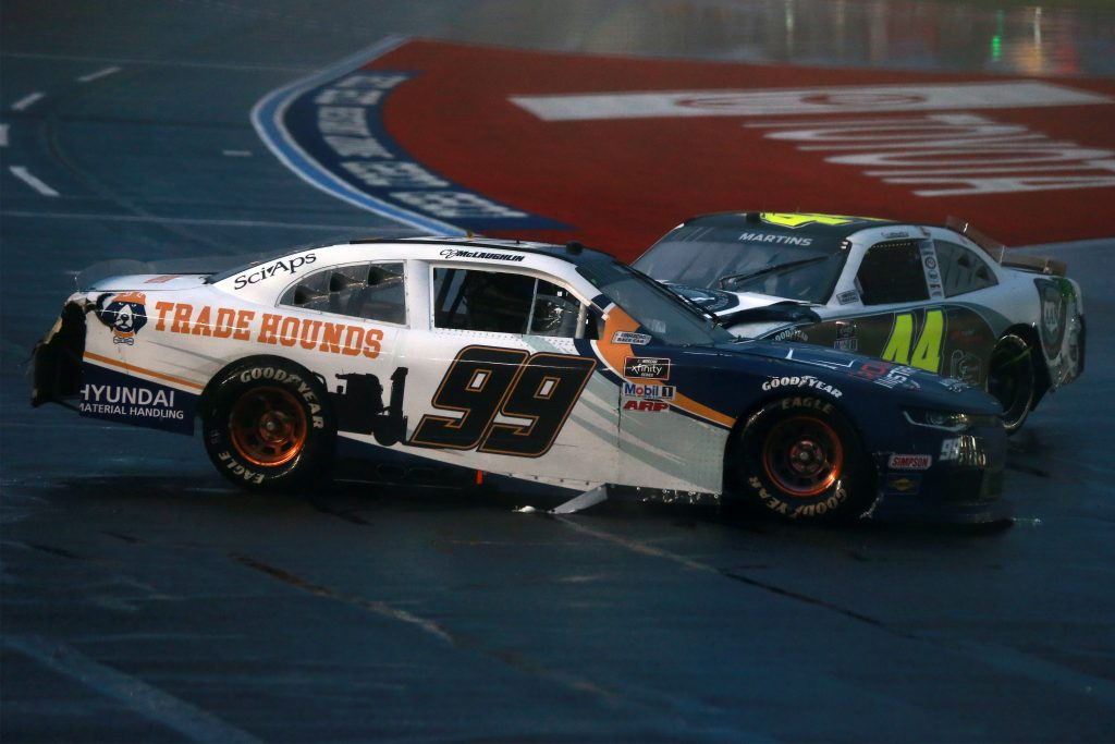 CONCORD, NORTH CAROLINA - OCTOBER 10: CJ McLaughlin, driver of the #99 Hyundai Material Handling Chevrolet, and Tommy Joe Martins, driver of the #44 AAN Adjusters Chevrolet, are involved in an on-track incident during the NASCAR Xfinity Series Drive for the Cure 250 presented by Blue Cross Blue Shield of North Carolina at Charlotte Motor Speedway on October 10, 2020 in Concord, North Carolina. (Photo by Sean Gardner/Getty Images) | Getty Images