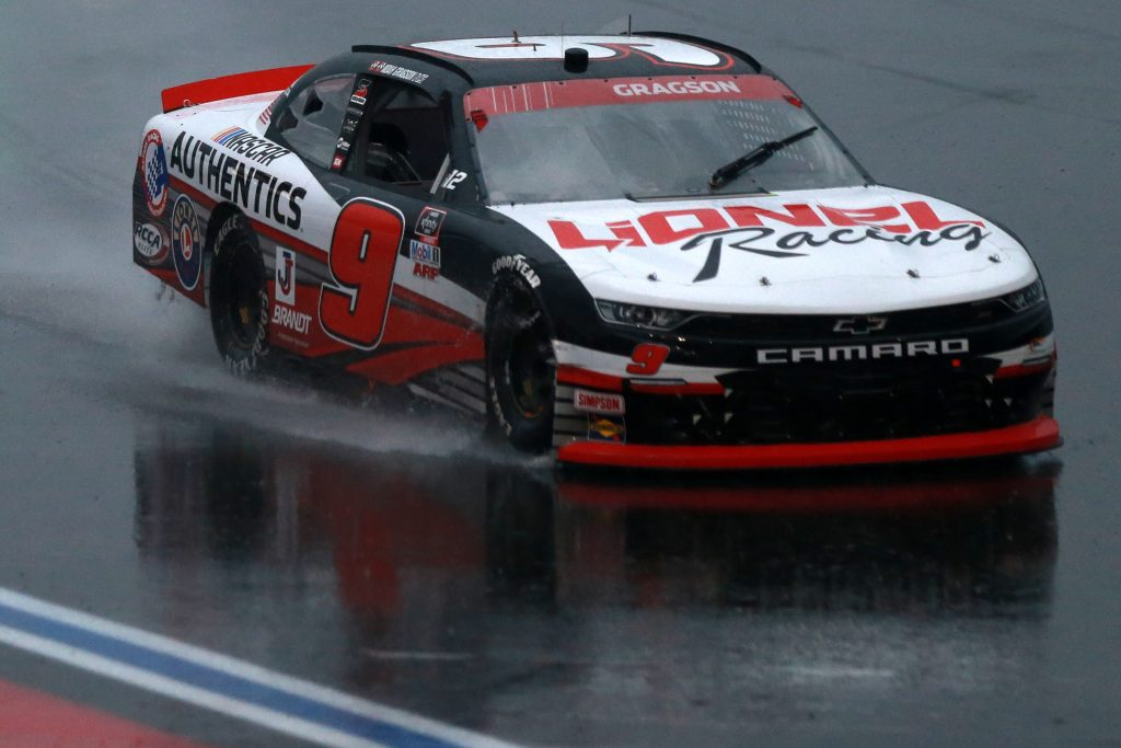 CONCORD, NORTH CAROLINA - OCTOBER 10: Noah Gragson, driver of the #9 Lionel Racing Chevrolet, drives in the rain during the NASCAR Xfinity Series Drive for the Cure 250 presented by Blue Cross Blue Shield of North Carolina at Charlotte Motor Speedway on October 10, 2020 in Concord, North Carolina. (Photo by Sean Gardner/Getty Images) | Getty Images