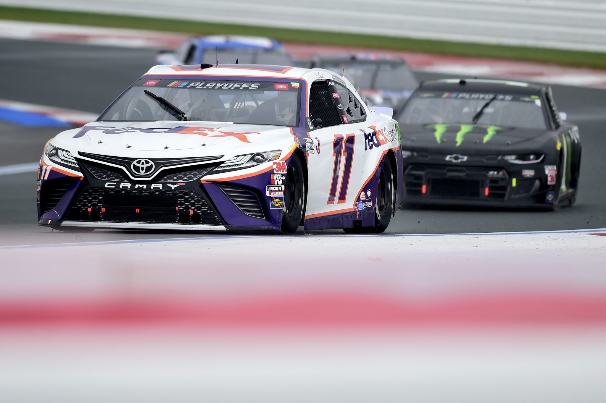CONCORD, NORTH CAROLINA - OCTOBER 11: Denny Hamlin, driver of the #11 FedEx Ground Toyota, leads the field during the NASCAR Cup Series Bank of America ROVAL 400 at Charlotte Motor Speedway on October 11, 2020 in Concord, North Carolina. (Photo by Jared C. Tilton/Getty Images) | Getty Images