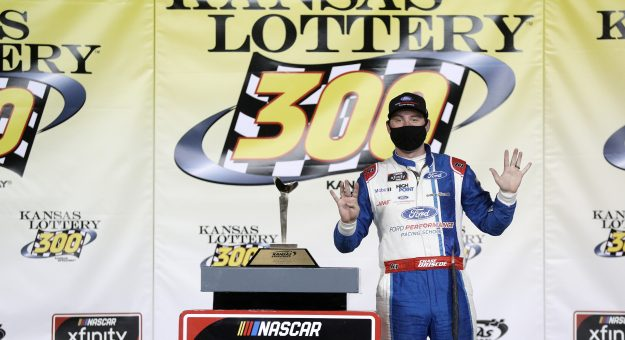 KANSAS CITY, KANSAS - OCTOBER 17: Chase Briscoe, driver of the #98 Ford Performance Racing School Ford, celebrates in victory lane after winning the NASCAR Xfinity Series Kansas Lottery 300 at Kansas Speedway on October 17, 2020 in Kansas City, Kansas. (Photo by Chris Graythen/Getty Images)   Getty Images