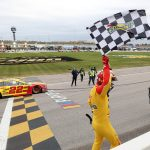 KANSAS CITY, KANSAS - OCTOBER 18: Joey Logano, driver of the #22 Shell Pennzoil Ford, celebrates with the checkered flag after winning the NASCAR Cup Series  Hollywood Casino 400 at Kansas Speedway on October 18, 2020 in Kansas City, Kansas. (Photo by Jamie Squire/Getty Images) | Getty Images