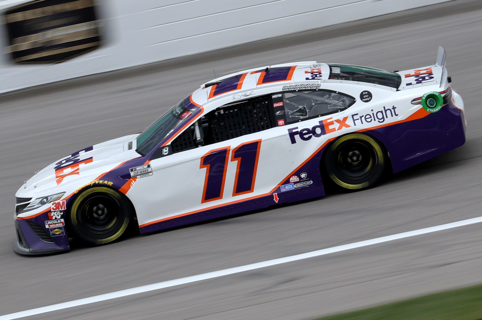 KANSAS CITY, KANSAS - OCTOBER 18: Denny Hamlin, driver of the #11 FedEx Freight Toyota, drives during the NASCAR Cup Series Hollywood Casino 400 at Kansas Speedway on October 18, 2020 in Kansas City, Kansas. (Photo by Chris Graythen/Getty Images) | Getty Images