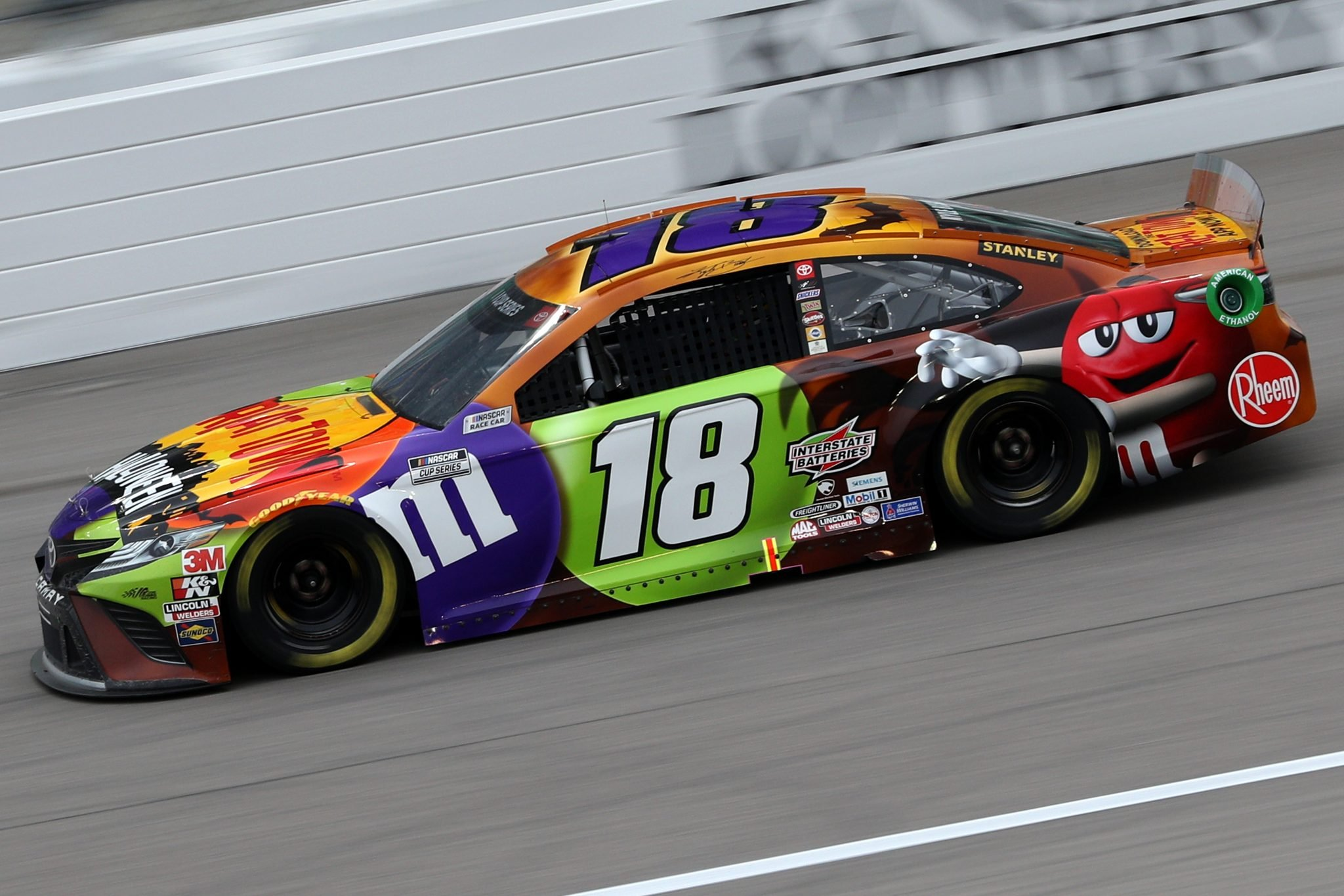 KANSAS CITY, KANSAS - OCTOBER 18: Kyle Busch, driver of the #18 M&M's Halloween Toyota, drives during the NASCAR Cup Series Hollywood Casino 400 at Kansas Speedway on October 18, 2020 in Kansas City, Kansas. (Photo by Chris Graythen/Getty Images) | Getty Images