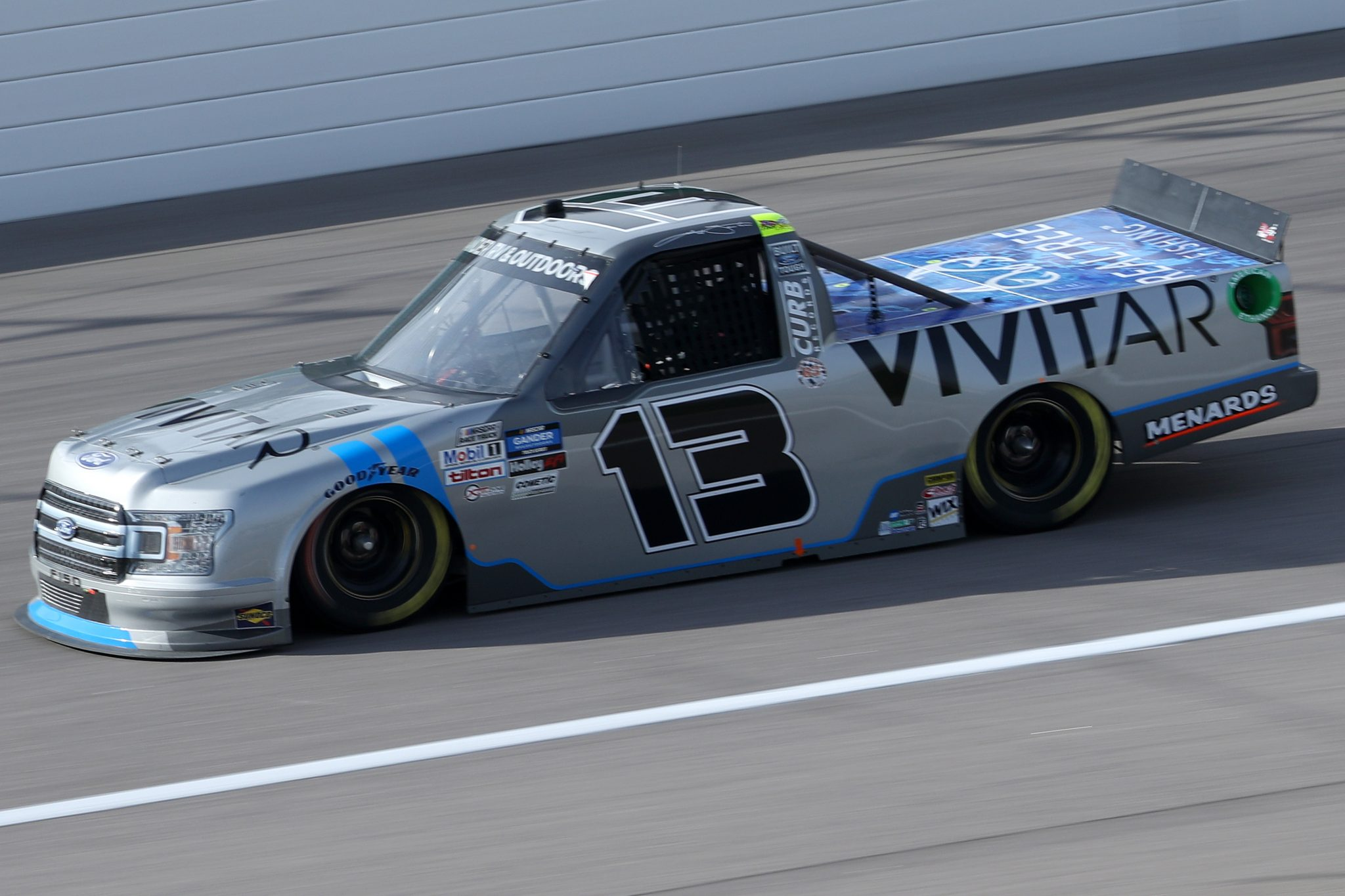 KANSAS CITY, KANSAS - OCTOBER 17: Johnny Sauter, driver of the #13 Vivitar Ford, drives during the NASCAR Gander RV & Outdoors Truck Series Clean Harbors 200at Kansas Speedway on October 17, 2020 in Kansas City, Kansas. (Photo by Chris Graythen/Getty Images) | Getty Images