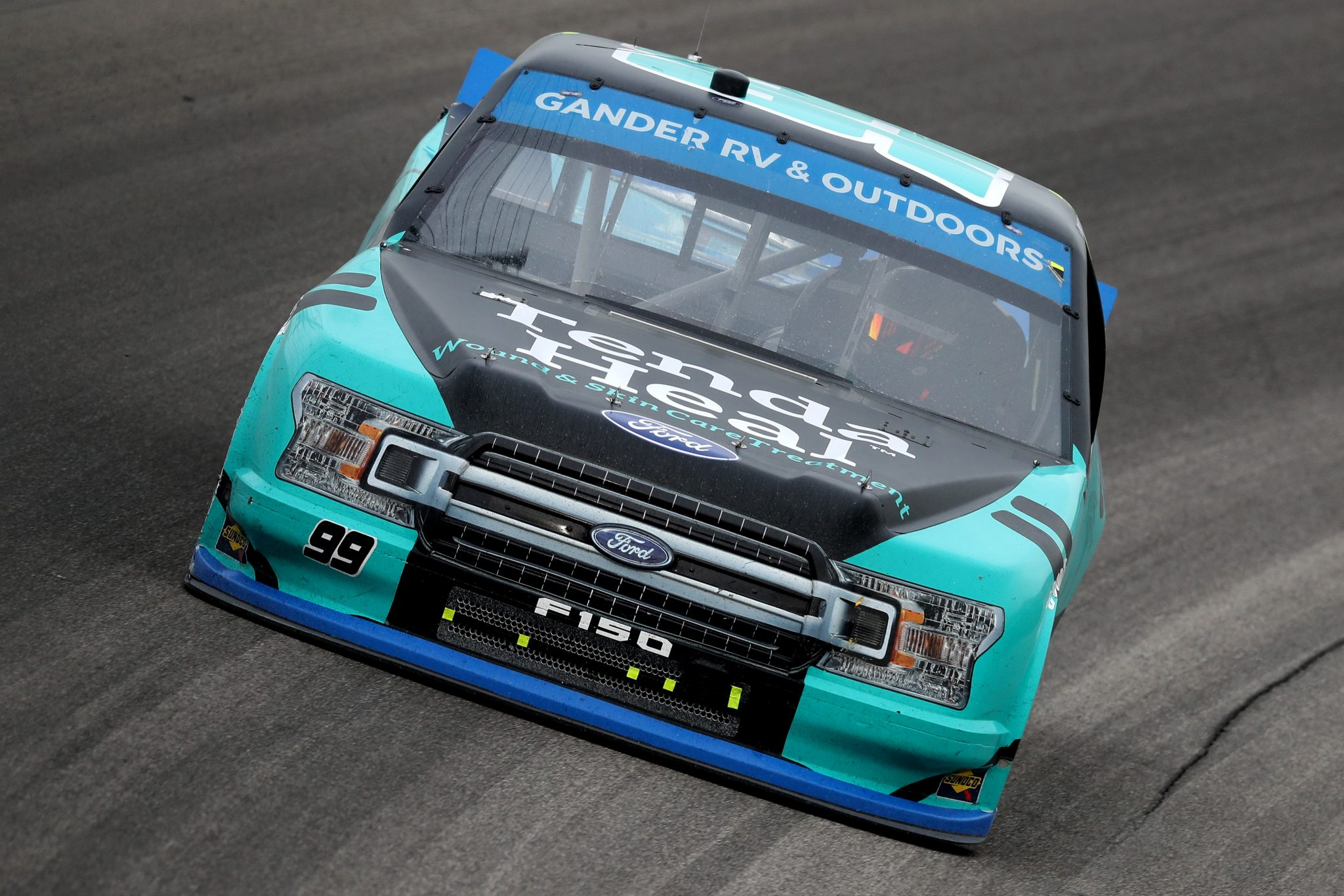 KANSAS CITY, KANSAS - OCTOBER 17: Ben Rhodes, driver of the #99 Tenda Heal Ford, drives during the NASCAR Gander RV & Outdoors Truck Series Clean Harbors 200at Kansas Speedway on October 17, 2020 in Kansas City, Kansas. (Photo by Jamie Squire/Getty Images) | Getty Images