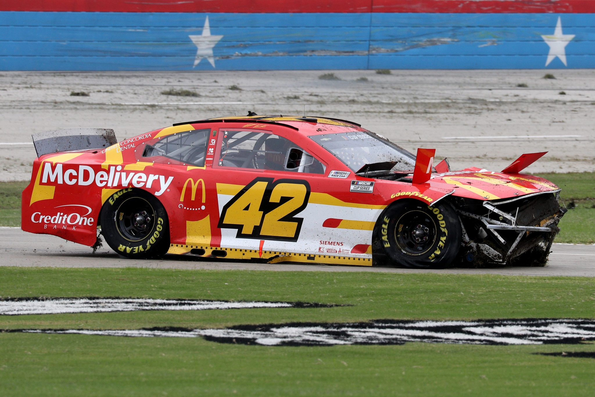 FORT WORTH, TEXAS - OCTOBER 28: Matt Kenseth, driver of the #42 McDonald's Chevrolet, spins into the infield grass after an on-track incident during the NASCAR Cup Series Autotrader EchoPark Automotive 500 at Texas Motor Speedway on October 28, 2020 in Fort Worth, Texas. (Photo by Chris Graythen/Getty Images) | Getty Images