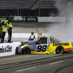 MARTINSVILLE, VIRGINIA - OCTOBER 30: Grant Enfinger, driver of the #98 Champion/Curb Records Ford, celebrates with a burnout after winning the NASCAR Gander RV & Outdoors Truck Series NASCAR Hall of Fame 200 at Martinsville Speedway on October 30, 2020 in Martinsville, Virginia. (Photo by Brian Lawdermilk/Getty Images) | Getty Images