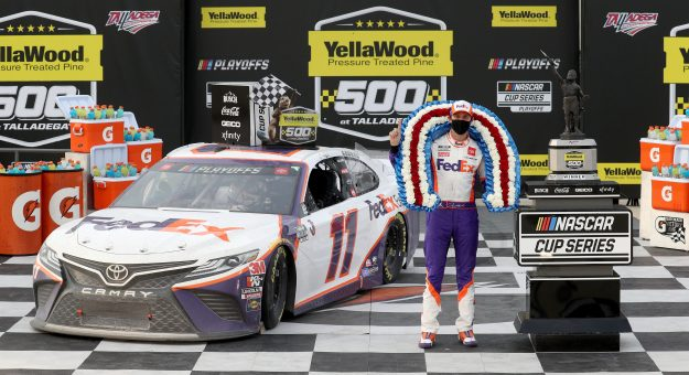 TALLADEGA, ALABAMA - OCTOBER 04: Denny Hamlin, driver of the #11 FedEx Express Toyota, celebrates in Victory Lane after winning the NASCAR Cup Series YellaWood 500 at Talladega Superspeedway on October 04, 2020 in Talladega, Alabama. (Photo by Chris Graythen/Getty Images)   Getty Images