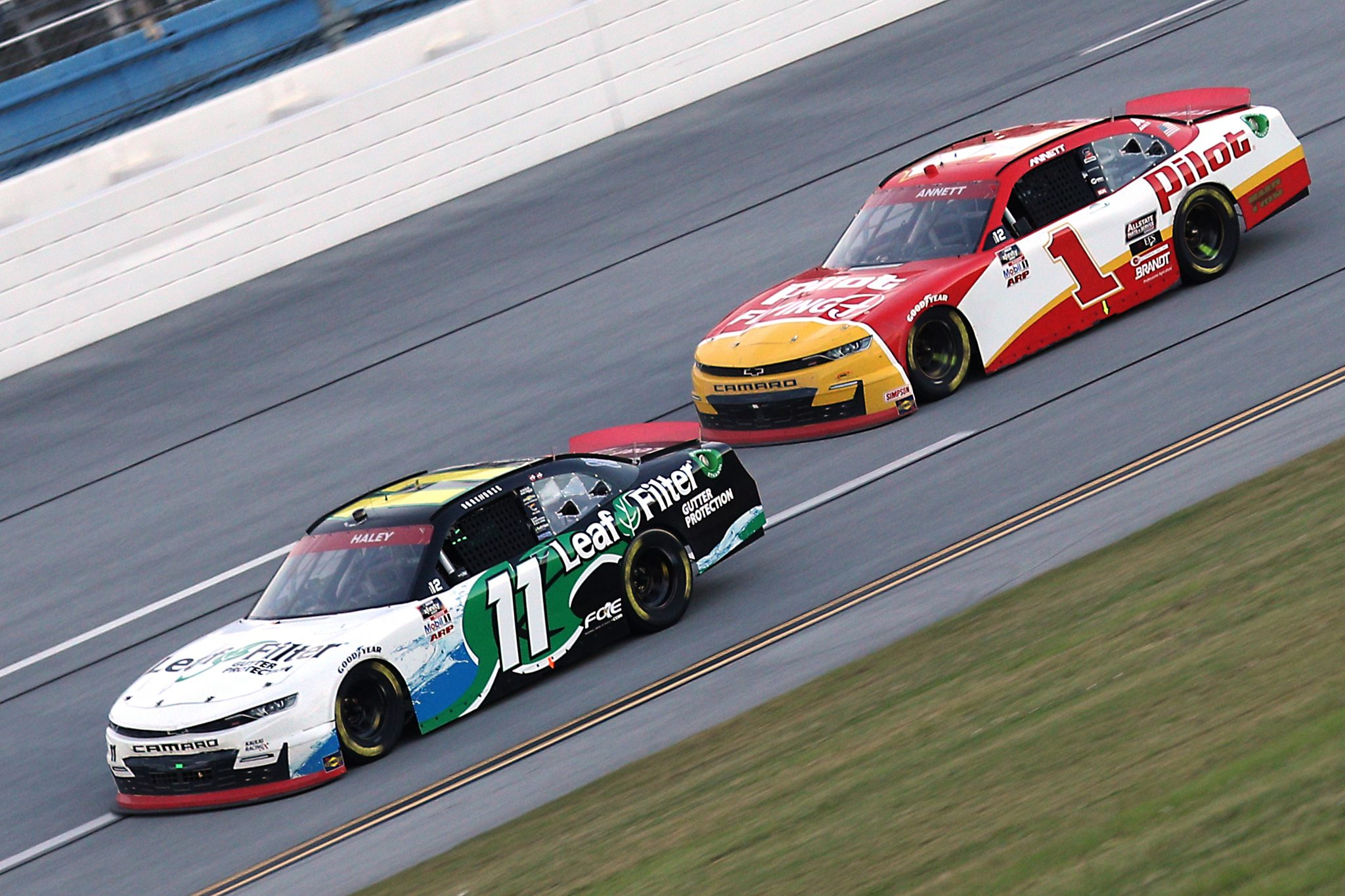 TALLADEGA, ALABAMA - OCTOBER 03: Justin Haley, driver of the #11 LeafFilter Gutter Protection Chevrolet, and Michael Annett, driver of the #1 Pilot Flying J Chevrolet, race during the NASCAR Xfinity Series Ag-Pro 300 at Talladega Superspeedway on October 03, 2020 in Talladega, Alabama. (Photo by Chris Graythen/Getty Images) | Getty Images