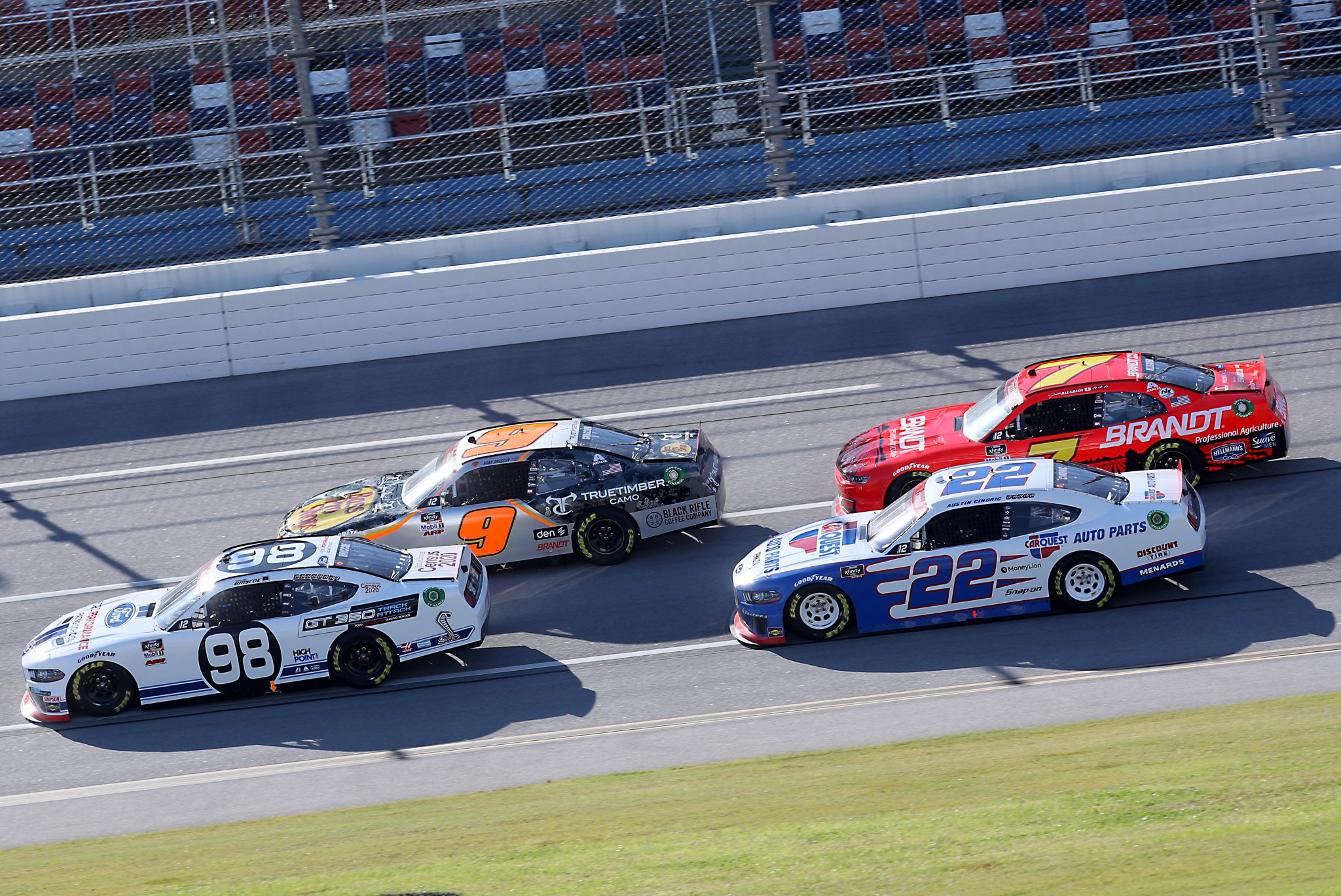 TALLADEGA, ALABAMA - OCTOBER 03: Chase Briscoe, driver of the #98 Ford Performance Racing School Ford, Noah Gragson, driver of the #9 Bass Pro Shops/TrueTimber Camo Chevrolet, Austin Cindric, driver of the #22 Ford, and Justin Allgaier, driver of the #7 BRANDT Chevrolet, race during the NASCAR Xfinity Series Ag-Pro 300 at Talladega Superspeedway on October 03, 2020 in Talladega, Alabama. (Photo by Chris Graythen/Getty Images) | Getty Images