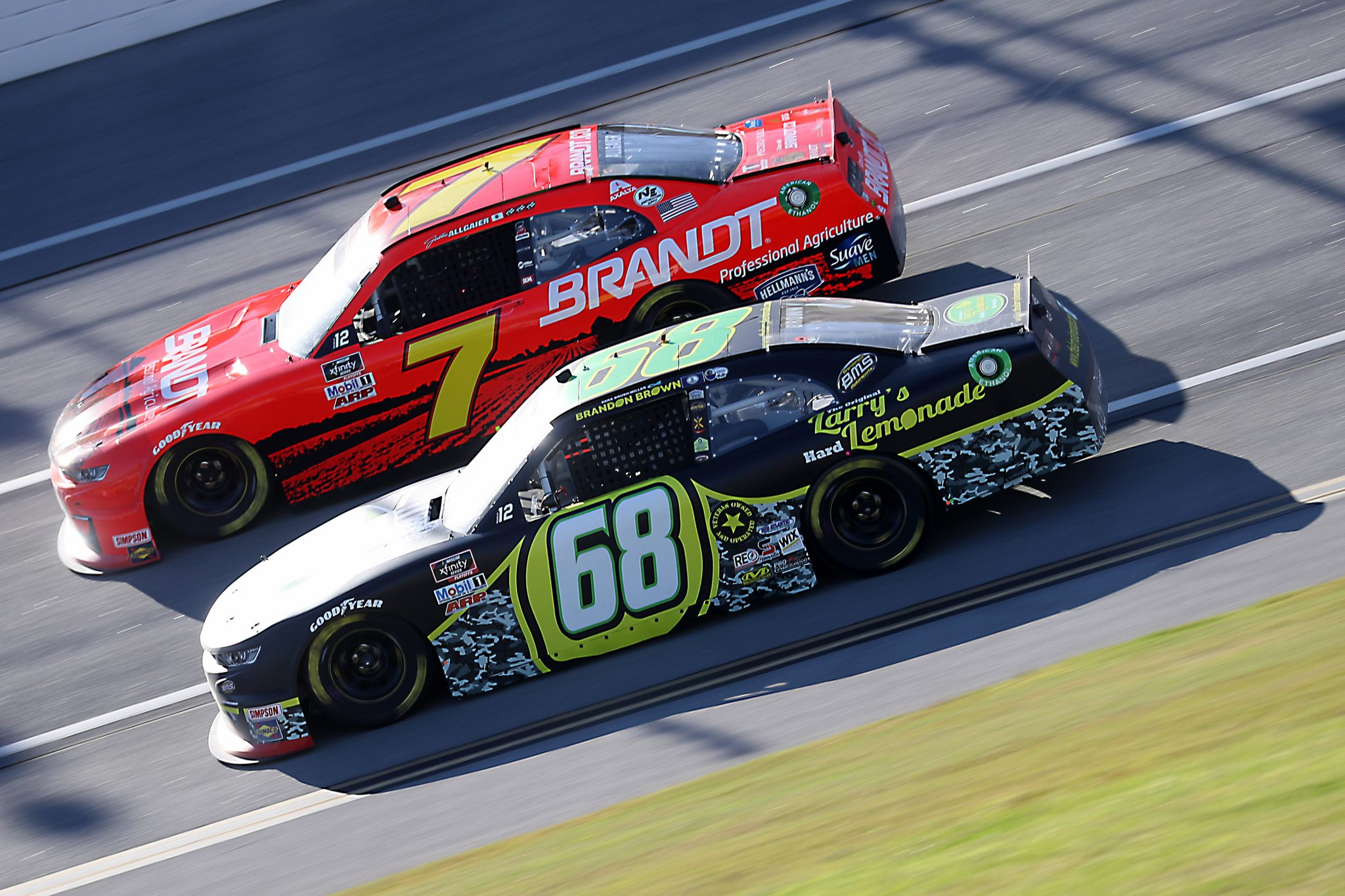 TALLADEGA, ALABAMA - OCTOBER 03: Justin Allgaier, driver of the #7 BRANDT Chevrolet, and Brandon Brown, driver of the #68 Original Larry's Hard Lemonade Chevrolet, race during the NASCAR Xfinity Series Ag-Pro 300 at Talladega Superspeedway on October 03, 2020 in Talladega, Alabama. (Photo by Chris Graythen/Getty Images) | Getty Images
