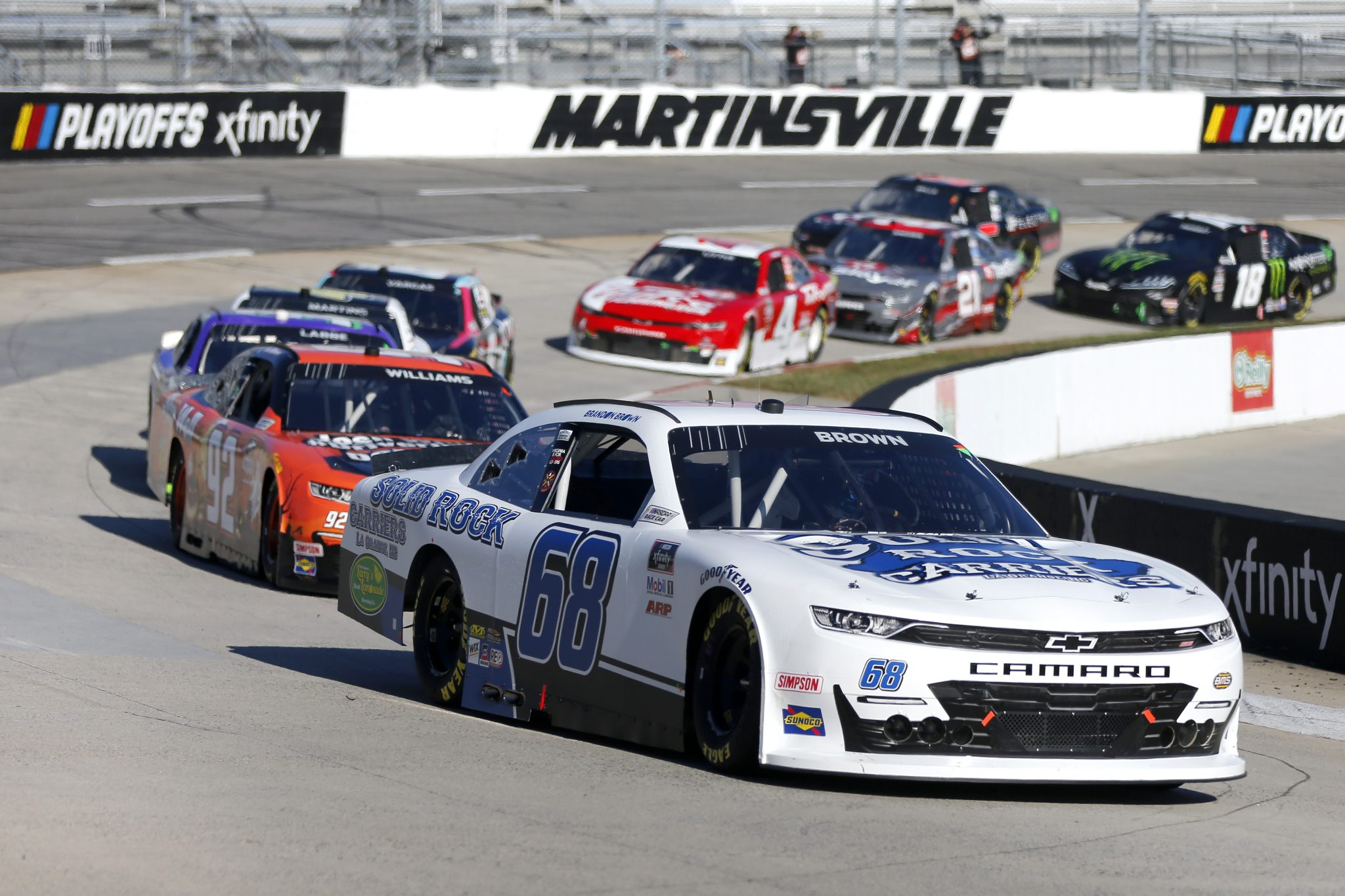 MARTINSVILLE, VIRGINIA - OCTOBER 31: Brandon Brown, driver of the #68 Solid Rock Carriers Chevrolet, leads the field during the NASCAR Xfinity Series Draft Top 250 at Martinsville Speedway on October 31, 2020 in Martinsville, Virginia. (Photo by Brian Lawdermilk/Getty Images) | Getty Images