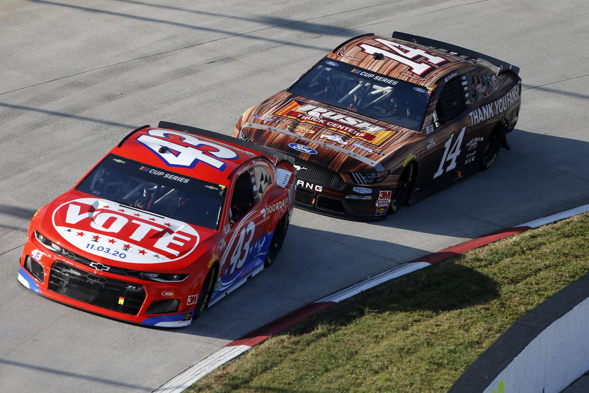 MARTINSVILLE, VIRGINIA - NOVEMBER 01: Bubba Wallace, driver of the #43 DoorDash Chevrolet, and Clint Bowyer, driver of the #14 Clint Bowyer Tribute Ford, race during the NASCAR Cup Series Xfinity 500 at Martinsville Speedway on November 01, 2020 in Martinsville, Virginia. (Photo by Brian Lawdermilk/Getty Images) | Getty Images