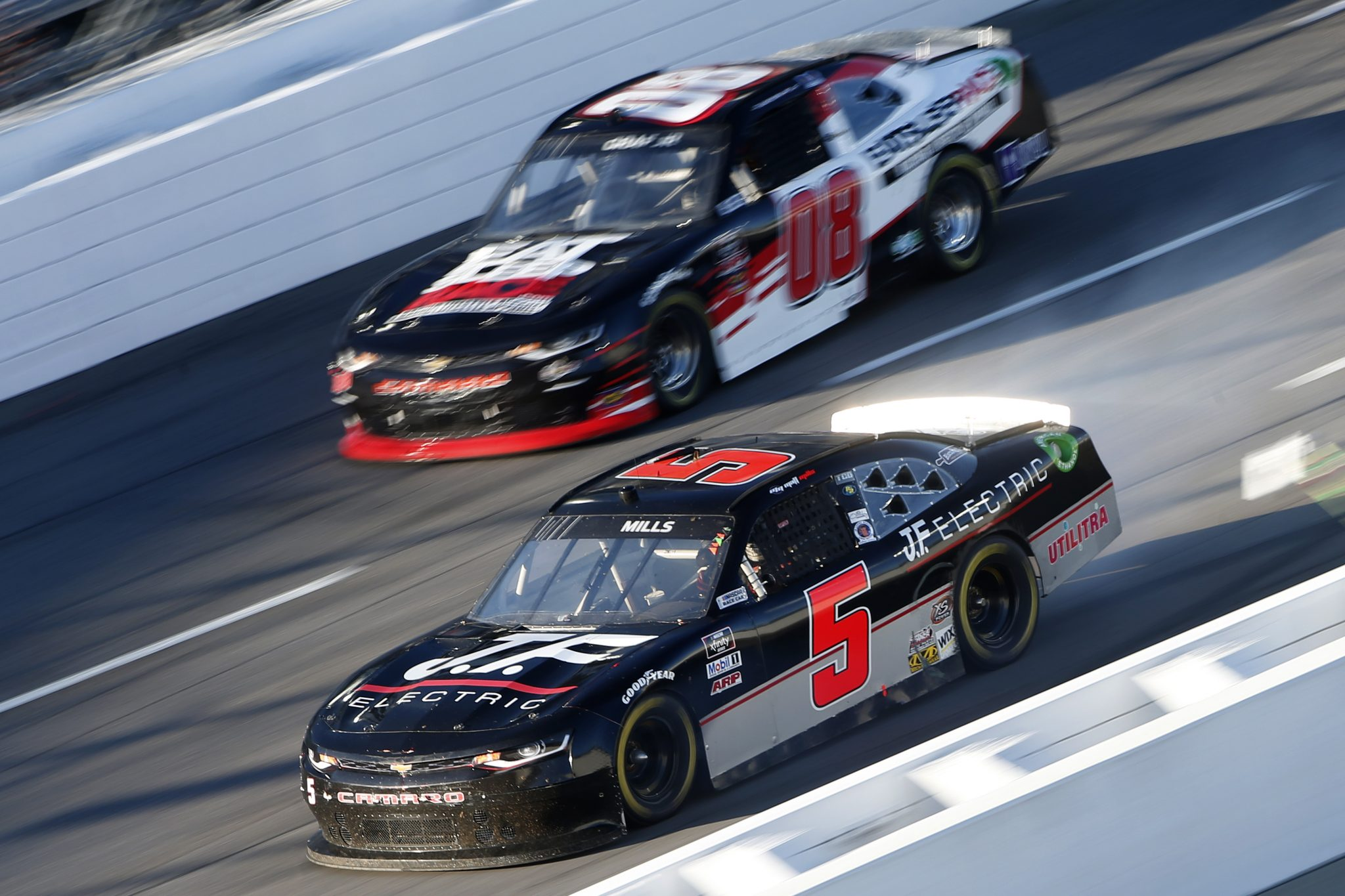MARTINSVILLE, VIRGINIA - OCTOBER 31: Matt Mills, driver of the #5 JF Electric Toyota, and Joe Graf Jr, driver of the #08 EAT SLEEP RACE Chevrolet, race during the NASCAR Xfinity Series Draft Top 250 at Martinsville Speedway on October 31, 2020 in Martinsville, Virginia. (Photo by Brian Lawdermilk/Getty Images) | Getty Images