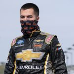 KANSAS CITY, KANSAS - OCTOBER 17: David Gravel, driver of the #24 ChevyGoods.com Chevrolet, walks the grid prior to the NASCAR Gander RV & Outdoors Truck Series Clean Harbors 200at Kansas Speedway on October 17, 2020 in Kansas City, Kansas. (Photo by Chris Graythen/Getty Images)   Getty Images