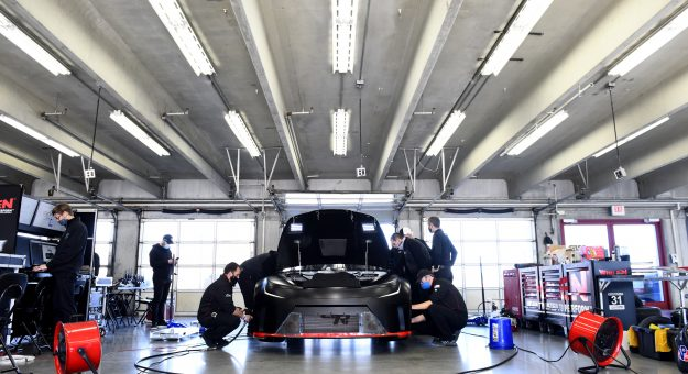 CONCORD, NORTH CAROLINA - NOVEMBER 16: Team members make adjustments to the NASCAR Next Gen car during the NASCAR Cup Series test at Charlotte Motor Speedway on November 16, 2020 in Concord, North Carolina. (Photo by Jared C. Tilton/Getty Images) | Getty Images