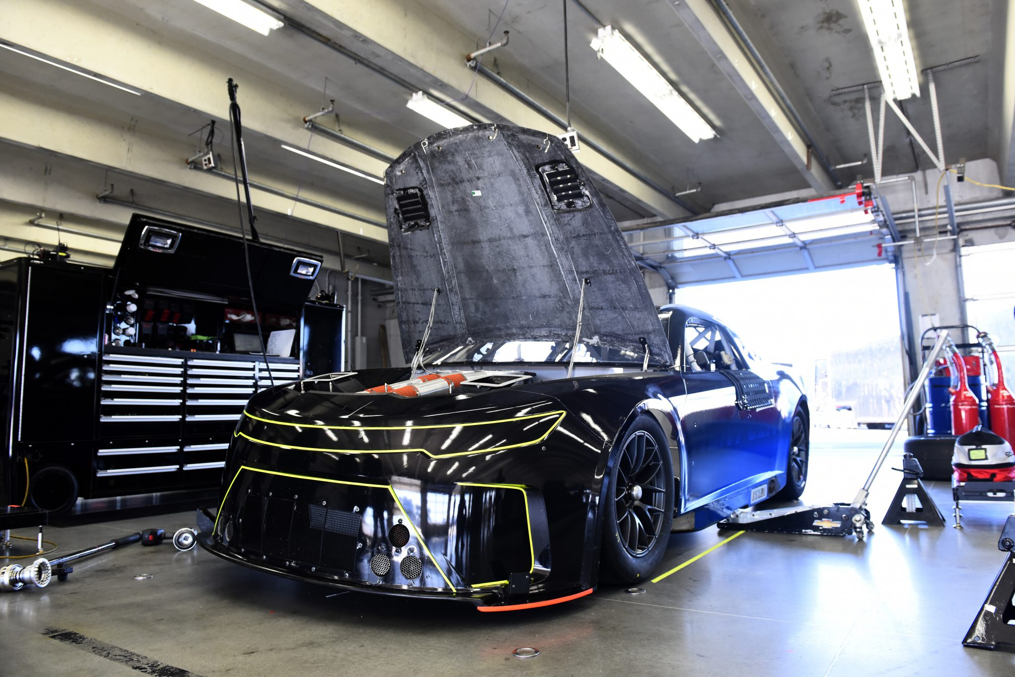 CONCORD, NORTH CAROLINA - NOVEMBER 16: The NASCAR Next Gen car waits in the garage area during the NASCAR Cup Series test at Charlotte Motor Speedway on November 16, 2020 in Concord, North Carolina. (Photo by Jared C. Tilton/Getty Images) | Getty Images