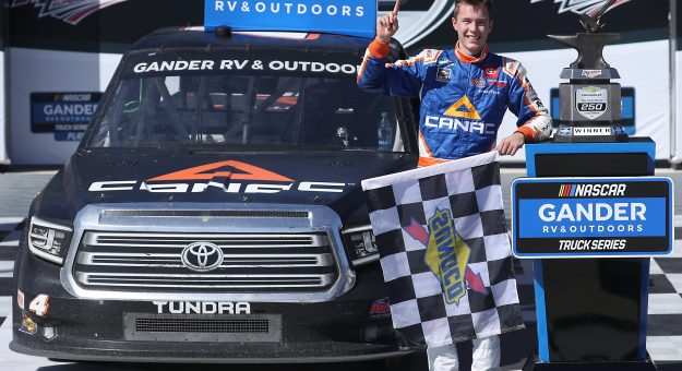 TALLADEGA, ALABAMA - OCTOBER 03: Raphael Lessard, driver of the #4 Canac Toyota, celebrates in Victory Lane after winning the NASCAR Gander RV & Outdoors Truck Series Chevy Silverado 250  at Talladega Superspeedway on October 03, 2020 in Talladega, Alabama. (Photo by Chris Graythen/Getty Images)   Getty Images