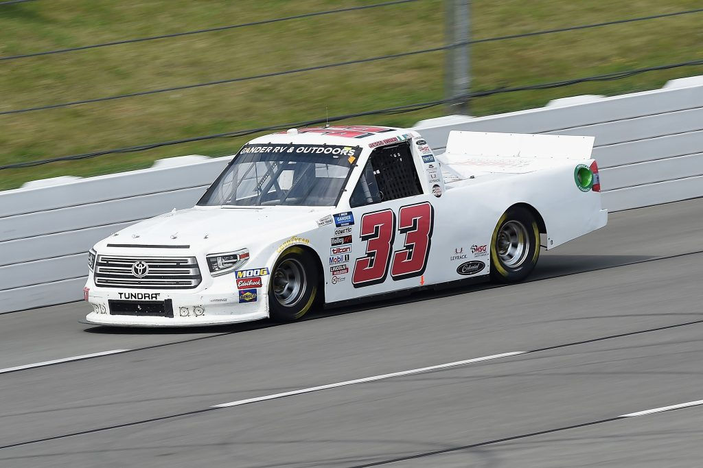 LONG POND, PENNSYLVANIA - JUNE 28: Jesse Iwuji, driver of the #33 Reaume Brothers Racing Toyota, drives during the NASCAR Gander RV & Outdoors Truck Series Pocono Organics 150 to benefit Farm Aid at Pocono Raceway on June 28, 2020 in Long Pond, Pennsylvania. (Photo by Jared C. Tilton/Getty Images) | Getty Images
