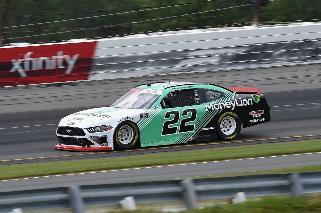 LONG POND, PENNSYLVANIA - JUNE 28: Austin Cindric, driver of the #22 MoneyLion Ford, drives during the NASCAR Xfinity Series Pocono Green 225 Recycled by J.P. Mascaro & Sons at Pocono Raceway on June 28, 2020 in Long Pond, Pennsylvania. (Photo by Jared C. Tilton/Getty Images) | Getty Images