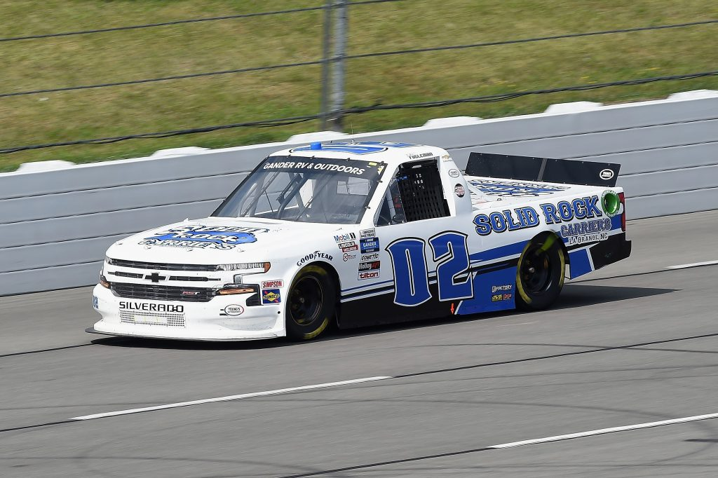 LONG POND, PENNSYLVANIA - JUNE 28: Tate Fogleman, driver of the #02 Solid Rock Carriers Chevrolet, drives during the NASCAR Gander RV & Outdoors Truck Series Pocono Organics 150 to benefit Farm Aid at Pocono Raceway on June 28, 2020 in Long Pond, Pennsylvania. (Photo by Jared C. Tilton/Getty Images) | Getty Images