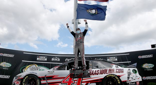 SPARTA, KENTUCKY - JULY 12: Cole Custer, driver of the #41 HaasTooling.com Ford, celebrates in Victory Lane after winning the NASCAR Cup Series Quaker State 400 Presented by Walmart at Kentucky Speedway on July 12, 2020 in Sparta, Kentucky. (Photo by Jared C. Tilton/Getty Images)   Getty Images