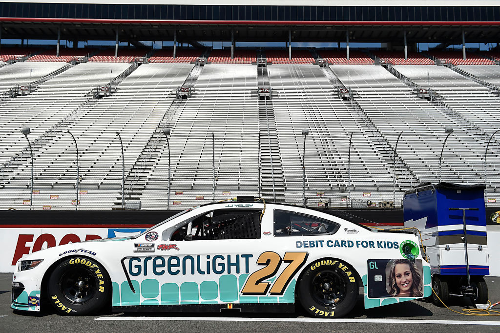 BRISTOL, TENNESSEE - JULY 15:  The #27 Greenlight Debit Card Ford, driven by JJ Yeley, sits on the grid prior to the NASCAR Cup Series All-Star Race at Bristol Motor Speedway on July 15, 2020 in Bristol, Tennessee. (Photo by Jared C. Tilton/Getty Images) | Getty Images