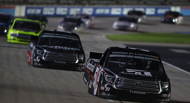 FORT WORTH, TEXAS - JULY 18: Kyle Busch, driver of the #51 Cessna Toyota, leads the field during the NASCAR Gander RV & Outdoors Truck Series Vankor 350 at Texas Motor Speedway on July 18, 2020 in Fort Worth, Texas. (Photo by Tom Pennington/Getty Images)   Getty Images