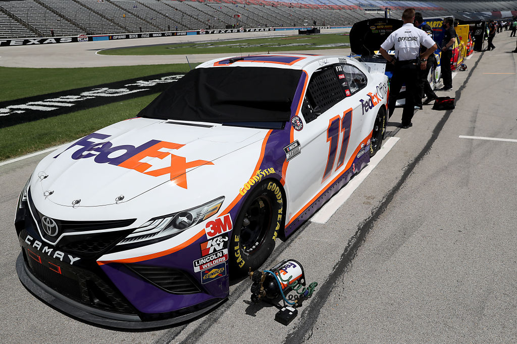 FORT WORTH, TEXAS - JULY 19: The #11 FedEx Office Toyota, driven by Denny Hamlin, waits on the grid prior to the NASCAR Cup Series O'Reilly Auto Parts 500 at Texas Motor Speedway on July 19, 2020 in Fort Worth, Texas. (Photo by Chris Graythen/Getty Images) | Getty Images