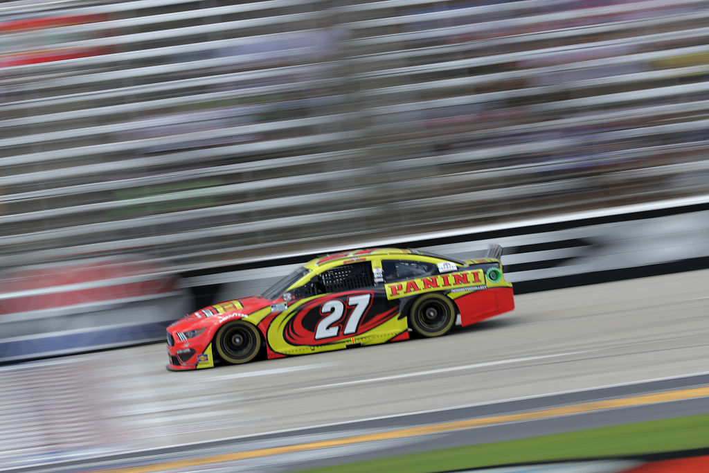 FORT WORTH, TEXAS - JULY 19: Gray Gaulding, driver of the #27 Panini America Ford, races during the NASCAR Cup Series O'Reilly Auto Parts 500 at Texas Motor Speedway on July 19, 2020 in Fort Worth, Texas. (Photo by Chris Graythen/Getty Images) | Getty Images