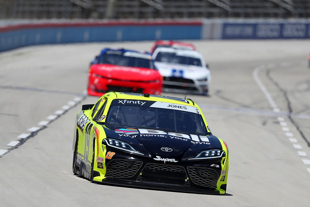 FORT WORTH, TEXAS - JULY 18: Brandon Jones, driver of the #19 Menards/Bali Toyota, leads a pack of cars during the NASCAR Xfinity Series Bariatric Solutions 300 at Texas Motor Speedway on July 18, 2020 in Fort Worth, Texas. (Photo by Tom Pennington/Getty Images) | Getty Images