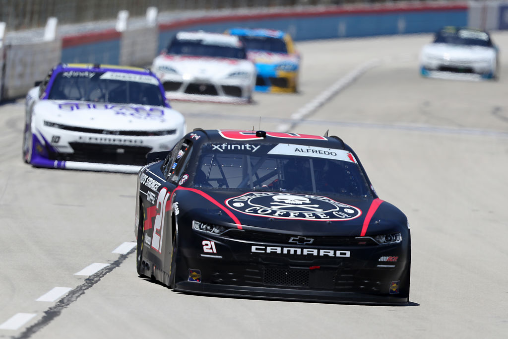 FORT WORTH, TEXAS - JULY 18: Anthony Alfredo, driver of the #21 Death Wish Coffee Chevrolet, leads a pack of cars during the NASCAR Xfinity Series Bariatric Solutions 300 at Texas Motor Speedway on July 18, 2020 in Fort Worth, Texas. (Photo by Tom Pennington/Getty Images)   Getty Images