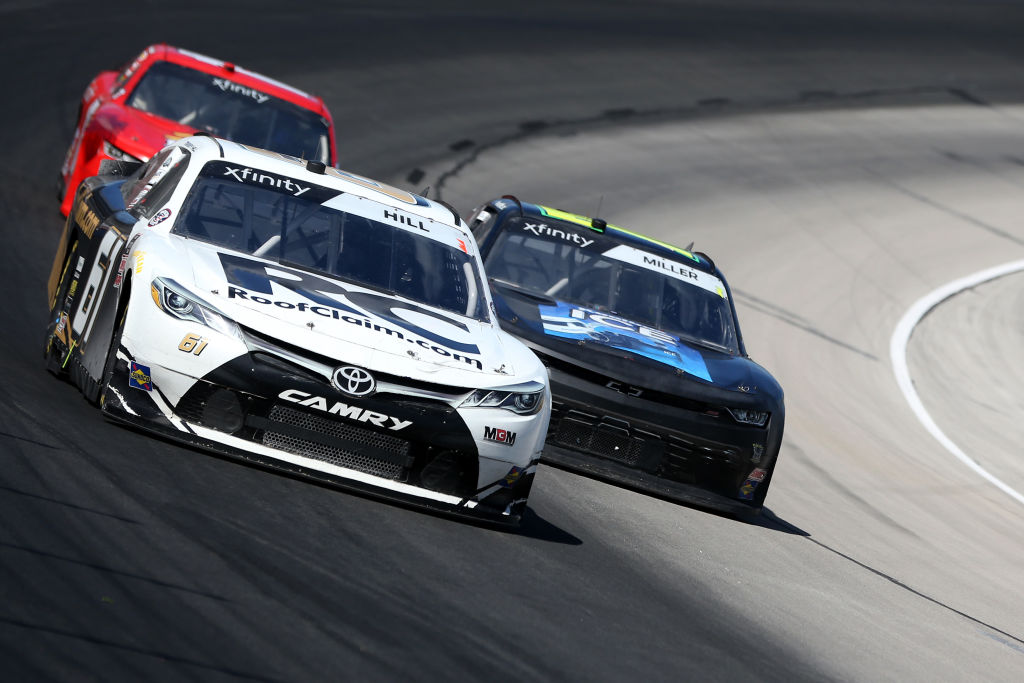 FORT WORTH, TEXAS - JULY 18: Timmy Hill, driver of the #61 AW North Carolina/AISIN Toyota, races Vinnie Miller, driver of the #78 Koolbox Chevrolet, during the NASCAR Xfinity Series Bariatric Solutions 300 at Texas Motor Speedway on July 18, 2020 in Fort Worth, Texas. (Photo by Brian Lawdermilk/Getty Images) | Getty Images