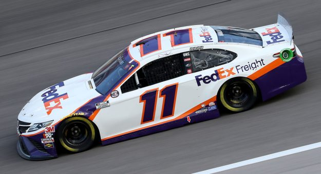 KANSAS CITY, KANSAS - JULY 23: Denny Hamlin, driver of the #11 FedEx Office Toyota, drives during the NASCAR Cup Series Super Start Batteries 400 Presented by O'Reilly Auto Parts at Kansas Speedway on July 23, 2020 in Kansas City, Kansas. (Photo by Jamie Squire/Getty Images) | Getty Images