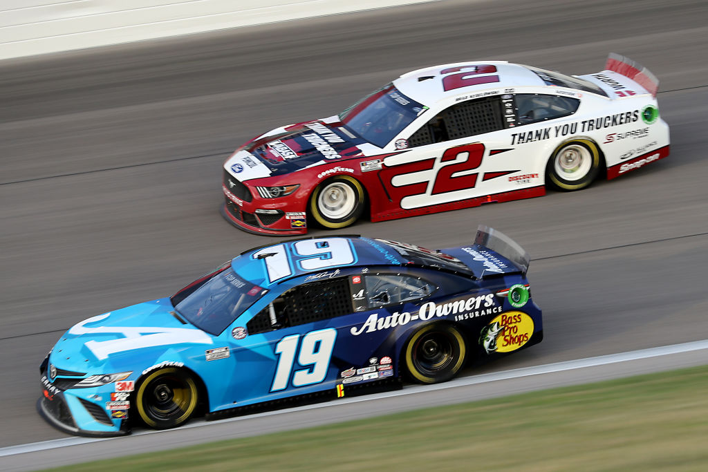 KANSAS CITY, KANSAS - JULY 23: Martin Truex Jr., driver of the #19 Auto Owner's Insurance Toyota, races Brad Keselowski, driver of the #2 Wabash Ford, during the NASCAR Cup Series Super Start Batteries 400 Presented by O'Reilly Auto Parts at Kansas Speedway on July 23, 2020 in Kansas City, Kansas. (Photo by Jamie Squire/Getty Images) | Getty Images