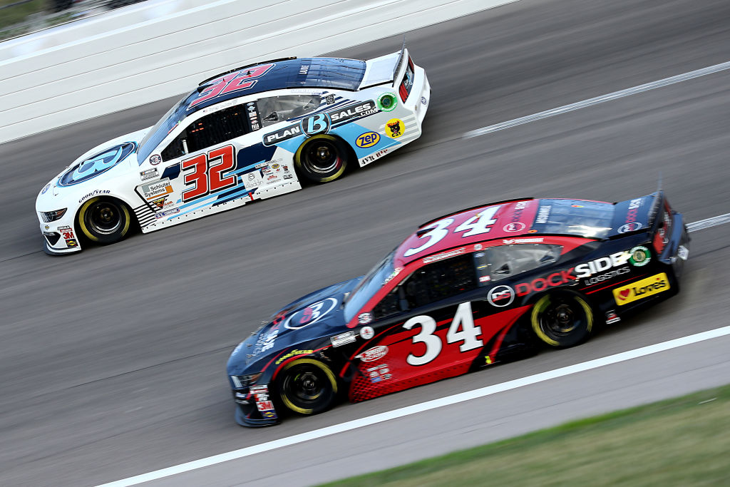 KANSAS CITY, KANSAS - JULY 23: Corey LaJoie, driver of the #32 Built Bar Ford, races Michael McDowell, driver of the #34 Dockside Logistics Ford, during the NASCAR Cup Series Super Start Batteries 400 Presented by O'Reilly Auto Parts at Kansas Speedway on July 23, 2020 in Kansas City, Kansas. (Photo by Jamie Squire/Getty Images) | Getty Images