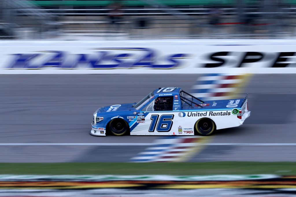 KANSAS CITY, KANSAS - JULY 24: Austin Hill, driver of the #16 United Rentals Toyota, crosses the finish line to win the NASCAR Gander RV & Outdoors Truck Series Kansas 200 at Kansas Speedway on July 24, 2020 in Kansas City, Kansas. (Photo by Jamie Squire/Getty Images) | Getty Images