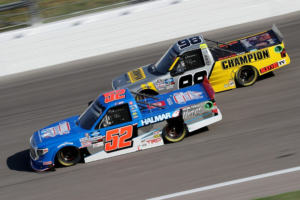 KANSAS CITY, KANSAS - JULY 24: Stewart Friesen, driver of the #52 Halmar Racing To Beat Hunger Toyota, races Grant Enfinger, driver of the #98 Champion Curb Records Ford, during the NASCAR Gander RV & Outdoors Truck Series Kansas 200 at Kansas Speedway on July 24, 2020 in Kansas City, Kansas. (Photo by Jamie Squire/Getty Images) | Getty Images