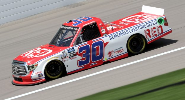 KANSAS CITY, KANSAS - JULY 25: Brennan Poole, driver of the #30 RememberEveryoneDeployed.org Toyota, drives during the NASCAR Gander RV & Outdoors Truck Series e.p.t 200 at Kansas Speedway on July 25, 2020 in Kansas City, Kansas. (Photo by Jamie Squire/Getty Images) | Getty Images